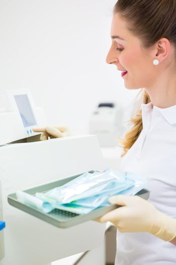 Assistant with sterile dentist tools