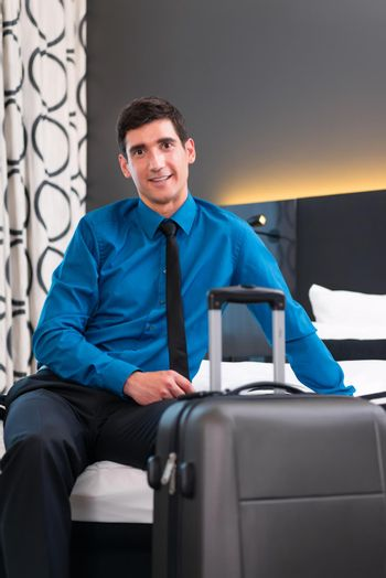 Businessman at arrival in hotel room
