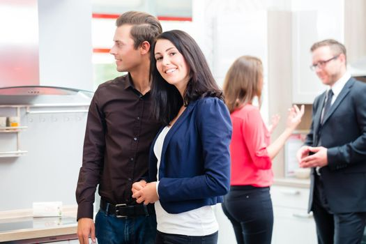 Couple in kitchen in store showroom