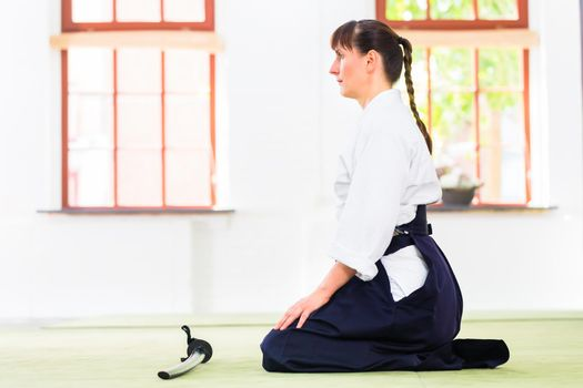 Woman at Aikido martial arts with sword