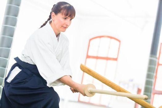 Woman having Aikido sword fight