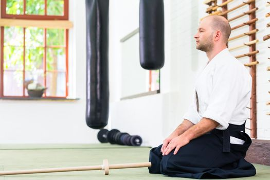 Man at Aikido martial arts with wooden sword