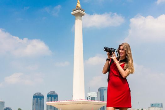 Tourist with camera sightseeing at Monumen Nasional