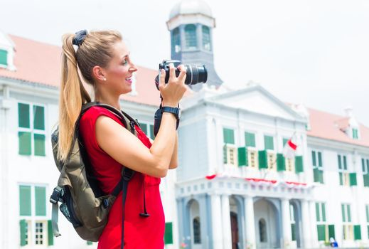 Tourist taking pictures sightseeing in Jakarta, Indonesia