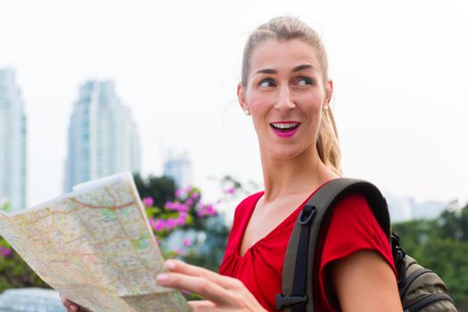 Tourist sightseeing with city map in Indonesia