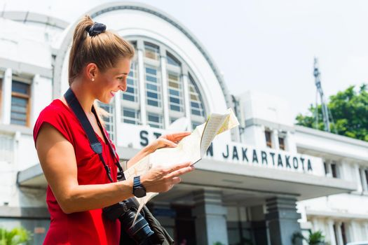 Tourist at sightseeing with bagpack in Indonesia