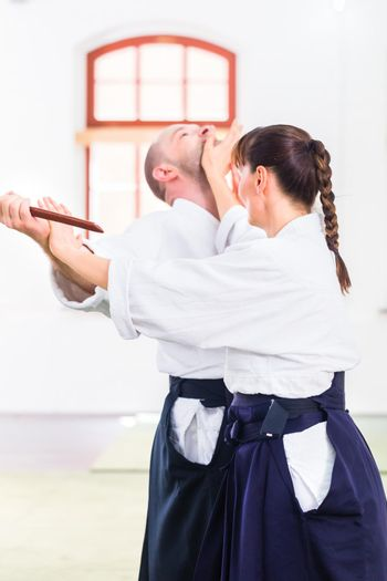 Man and woman having Aikido knife fight