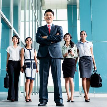 Asian business team marching into office