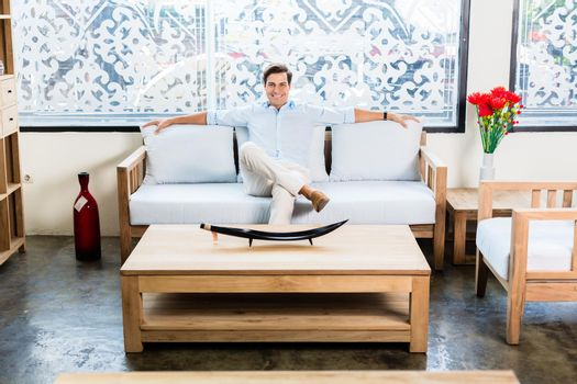 Man sitting on couch in furniture store showroom