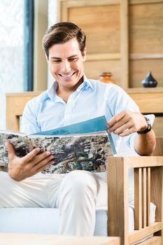 Man in furniture store browsing catalog