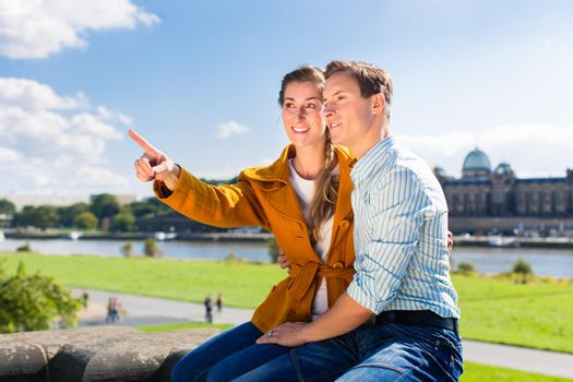 Man and woman in Dresden at Elbe riverbank