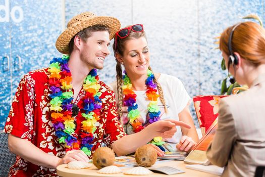 Good service in travel agency - man and woman booking a beach vacation