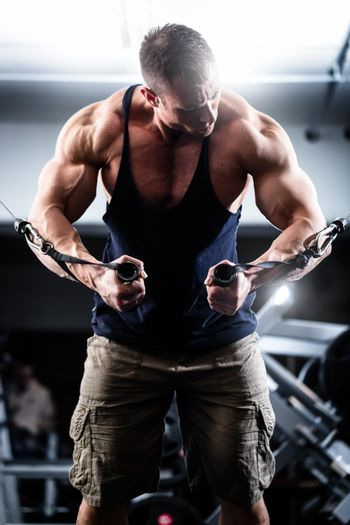 Bodybuilder doing butterfly on cable pull