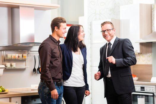 Couple consult salesman for domestic kitchen