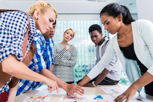Advertising agency team choosing key visual
