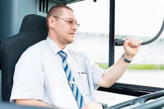 Bus driver making announcement using microphone
