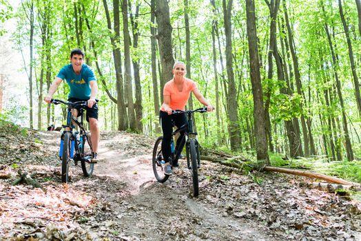 Couple on mountain bike bicycle