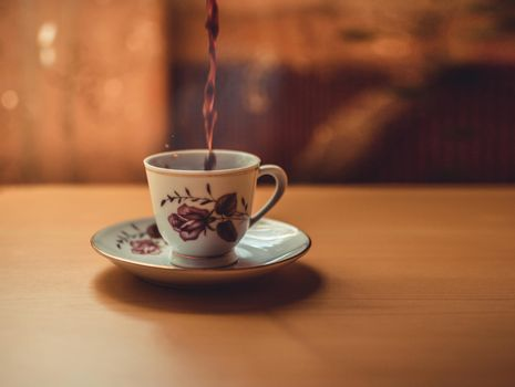 Photo of a cup of freshly brewed coffee, cup of coffee on wooden background, cup of coffee with copy space