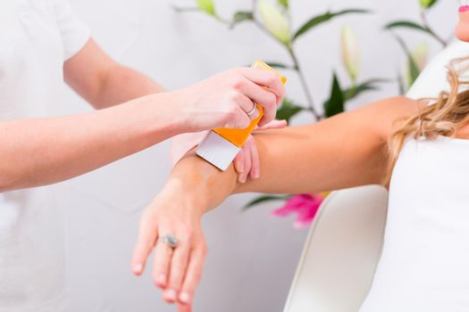 Woman at waxing hair removal in beauty parlor