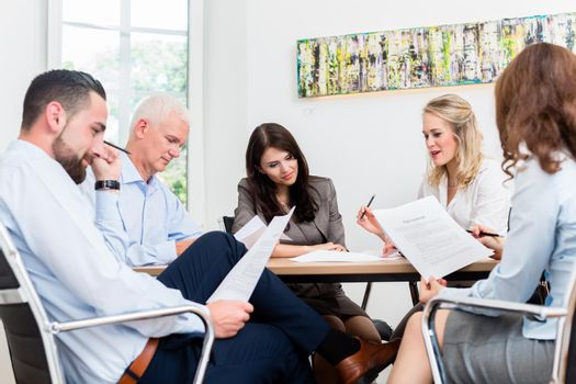 Lawyers having team meeting in law firm