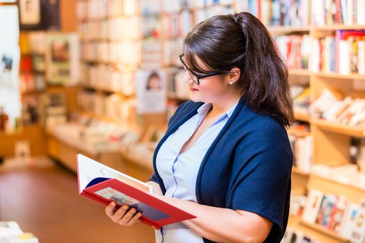 Woman buying books in bookstore