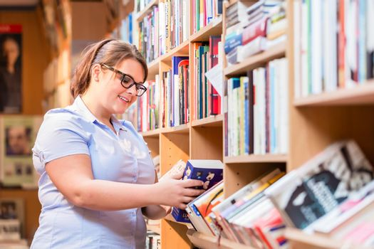 Woman in bookstore looking for book