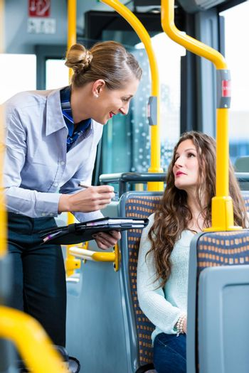 Woman in bus having no valid ticket at inspection