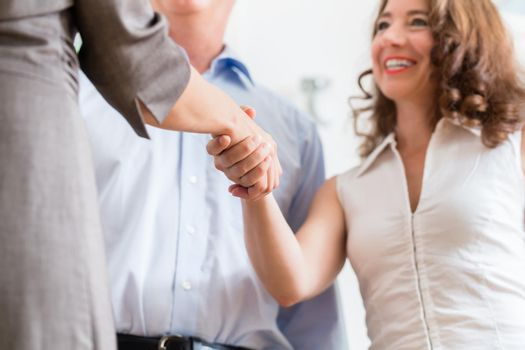 Business people doing handshake after agreement