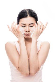 Woman applying facial moisturizer cream for sensitive skin