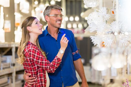 Customer in hardware store asking clerk for help