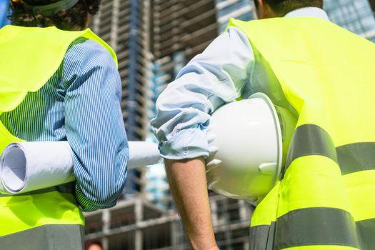 Civil engineers visiting building site