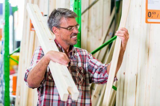 Customer in lumber department of hardware store