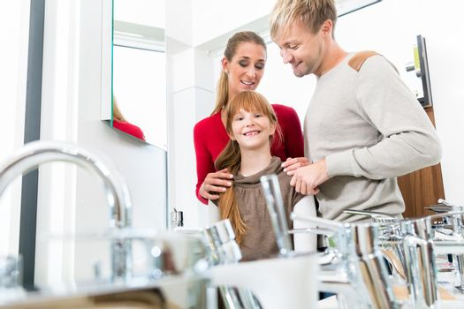 Portrait of a happy family together in the interior of a modern shop