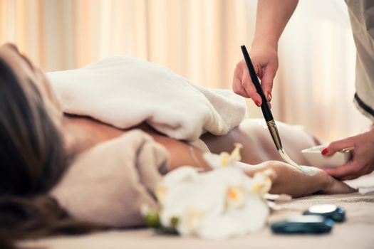 Woman relaxing at beauty center during treatment for skin rejuvenation
