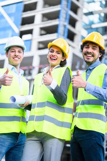 Team of civil engineers and architects at construction