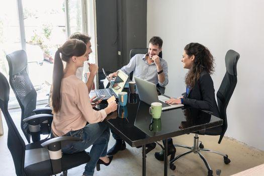 Team of creatives having meeting in agency office