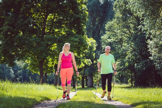 Couple doing Nordic Walking for sport