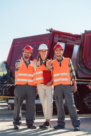 Colleagues in a freight forwarding company giving thumbs up