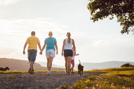Family and dog walking home