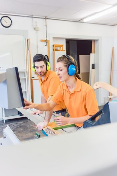 Carpenter programming computer controlled saw