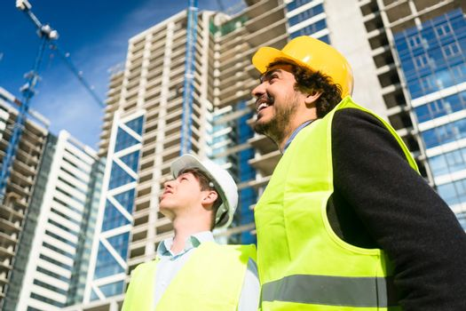 Architects on large construction site giving instructions