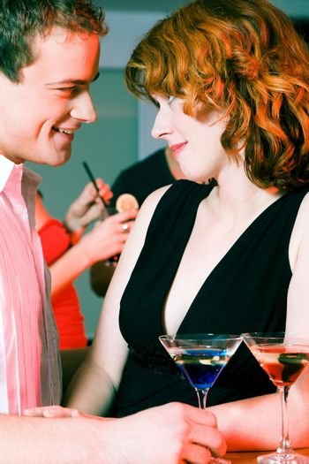 Couple flirting at a party
