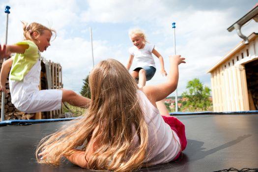 Kids jumping on trampoline