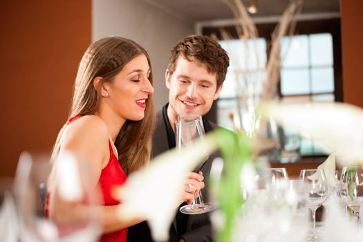 Couple Celebrating an Occasion in Restaurant