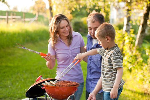 Family having BBQ in their garden