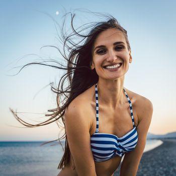 Woman on a pebble beach