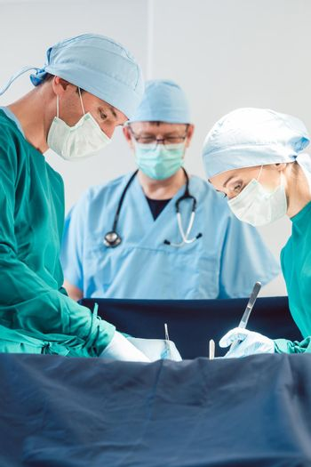 Surgical doctor in full concentration on operation