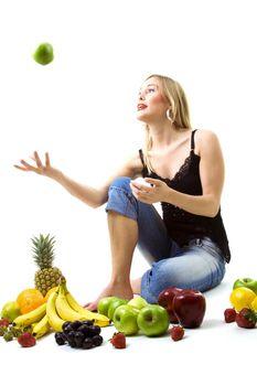 girl tossing green apple