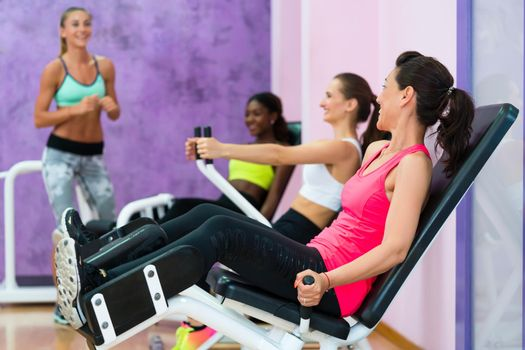 Fit woman listening to fitness instructor with sense of humor du