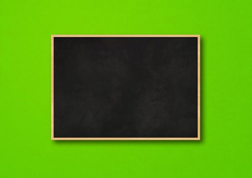 Traditional black board isolated on a green background